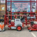 red machinery positioned outside tool centre