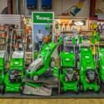 green Viking lawnmowers in a row