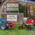 two garden machinery items outside of murray hire front door